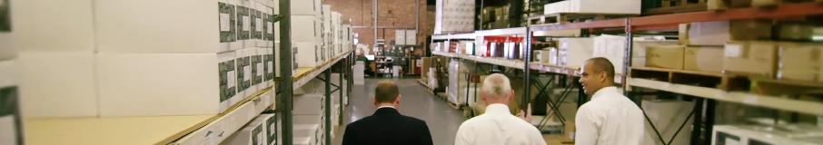 Image of men walking in a warehouse